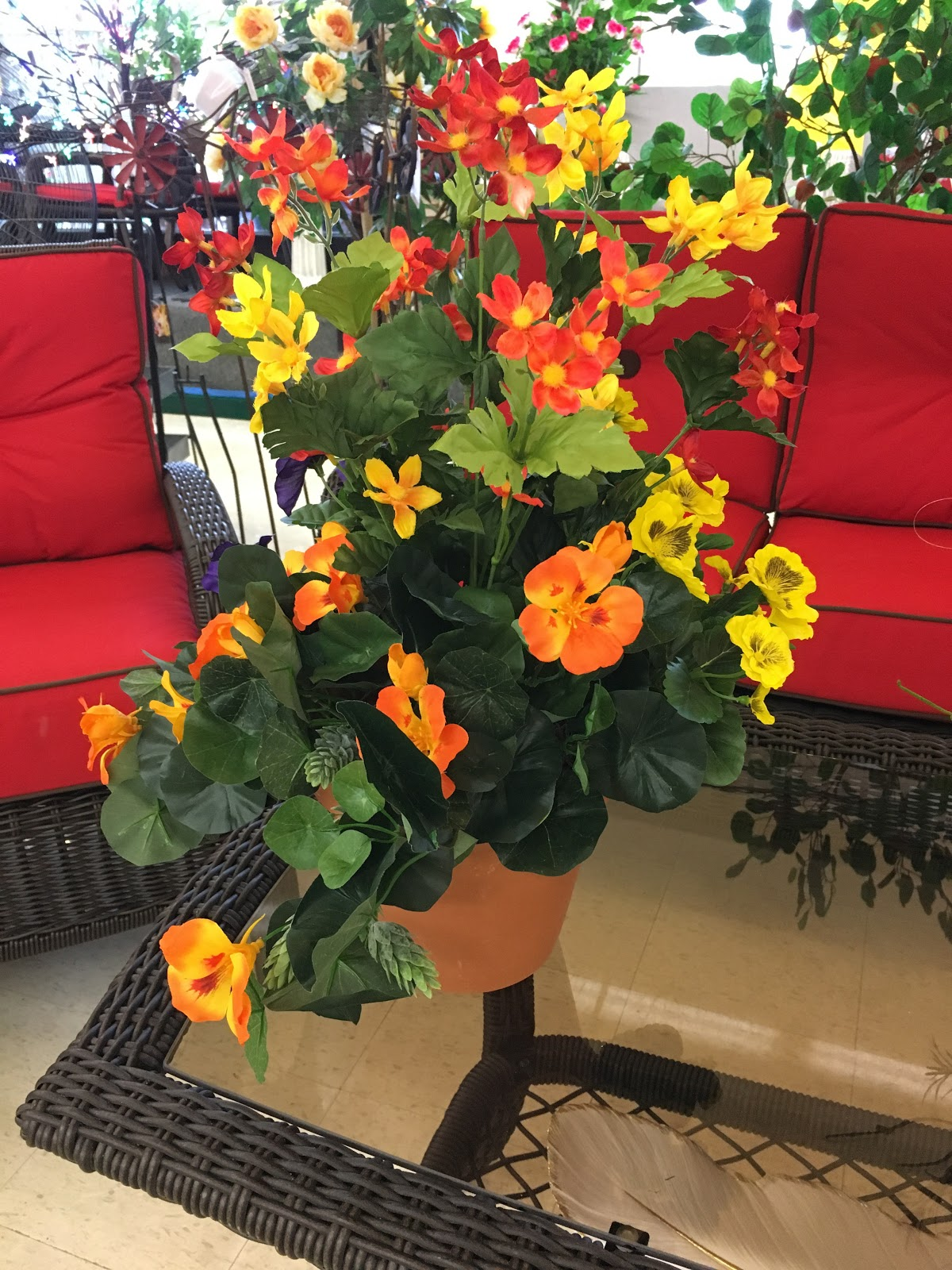 Orange and Yellow Artificial Flowers on Glass Table