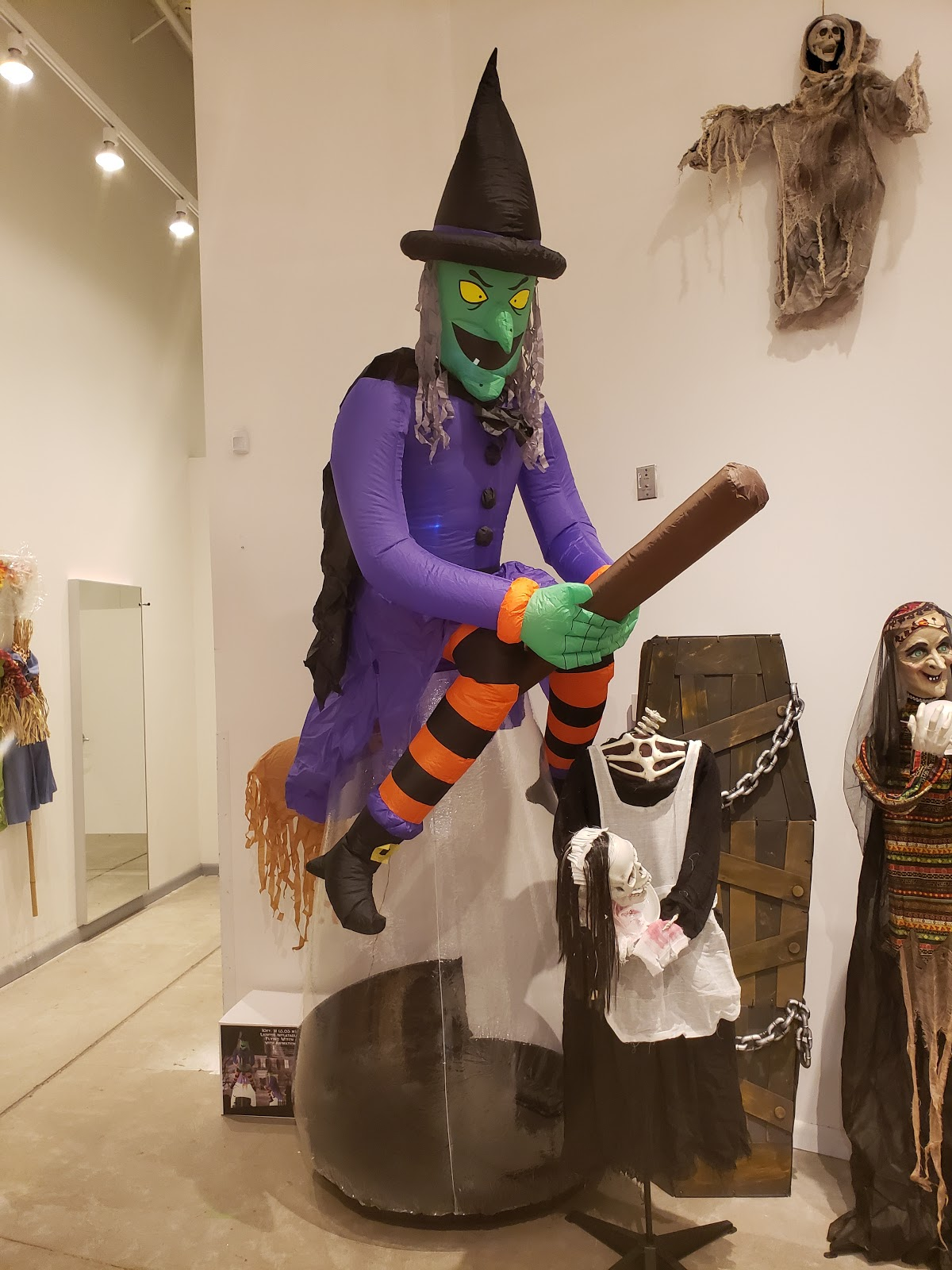 Large Witch On Broom On Display
