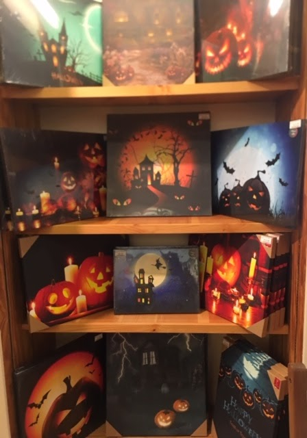 Halloween Wall Decor Pieces On Shelf