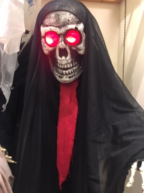 Skeleton With Red Glowing Eyes & Black Cape