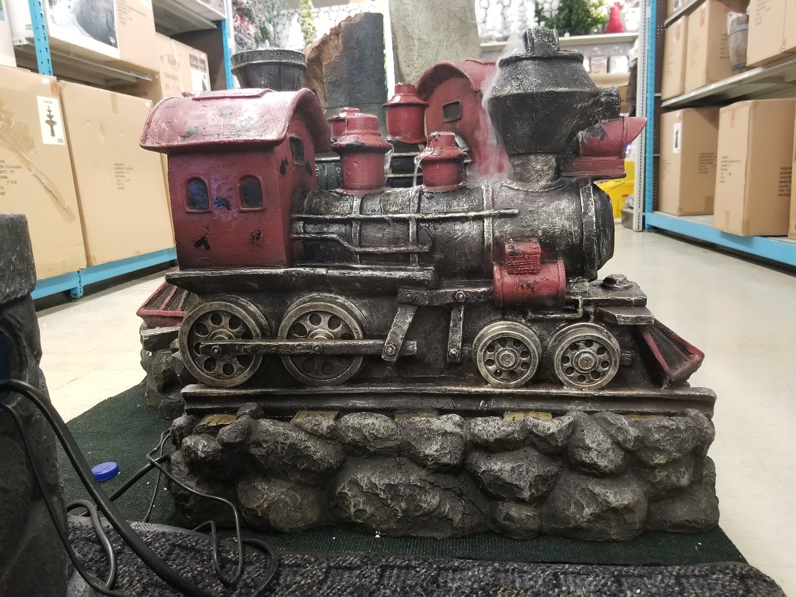 Outdoor Train Fountain On Display In Store