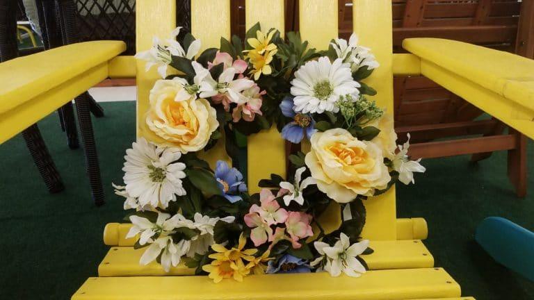 Floral wreath on garden chair